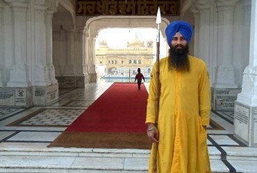 Golden temple with Sikh guard